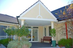 Aged care facility with open bright entrance