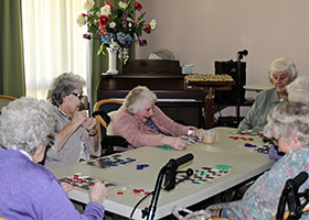 Elderly engaging, playing games in a nursing home