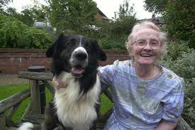 Elderly lady and her pet dog