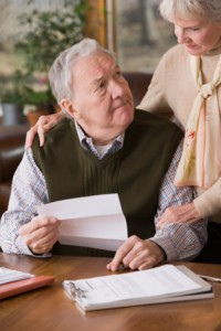 Worried elderly couple victims of identity theft