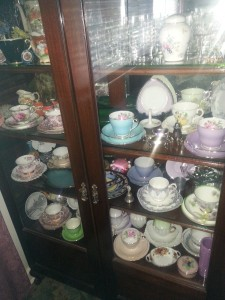 Crystal cabinet with tea cups.  June Senior of the month Val. leaveitwithme.com.au